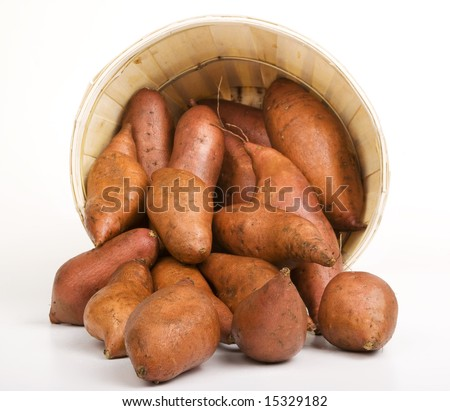 Red Sweet Potatoes pouring out of a Woven Basket