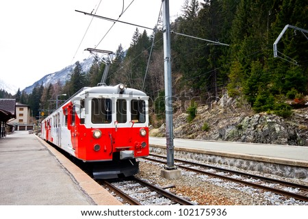 Red Swiss train stop at train at station