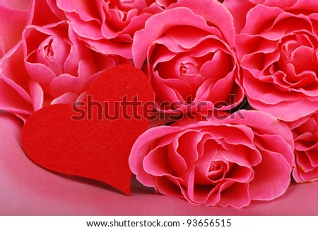 red symbol of heart with lovely roses as a Valentines card/cute heart with pink roses