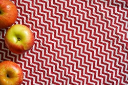 Red table cloth zigzag texture with apples
