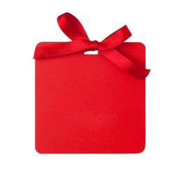 Red tag with bow  isolated on white