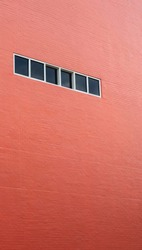 Red tall buildings with Windows