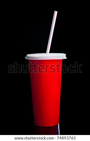 Red tall plastic glass with lid and straw isolated on black background