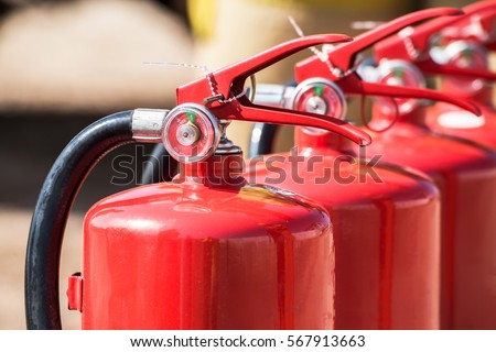 Red tank of fire extinguisher. Overview of a powerful industrial fire extinguishing system. Emergency equipment for industrial refinery crude oil and gas.compressed gas carbon dioxide in side.