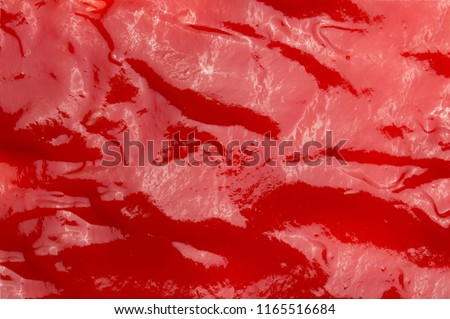Red tasty Ketchup or tomato sauce texture background