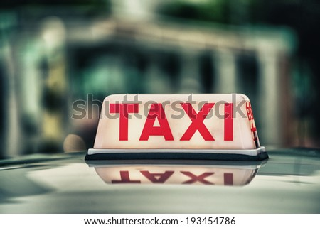 Red Taxi Sign