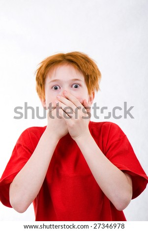 Red teen was frightened. The white background isolated