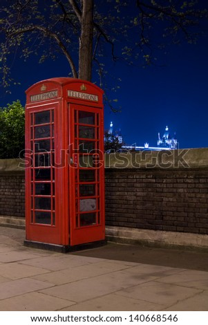 Red telephone and Tower Bridge at night, London, England