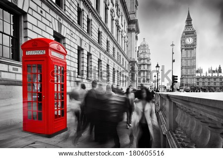 Red telephone booth and Big Ben in London England the UK People walking in rush The symbols of London in black on white