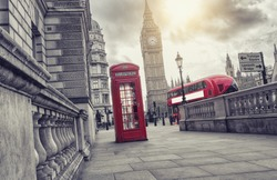 Red telephone booth and Big Ben with bus in London, England, the UK