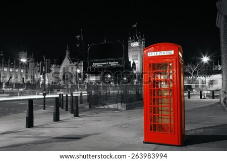 red telephone booth at night ...