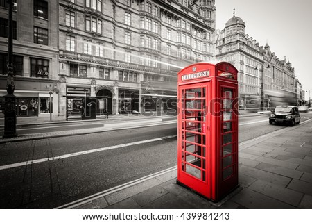 red telephone box in street...
