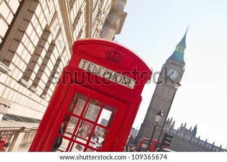 Red telephone box with Big Ben in background, London, UK