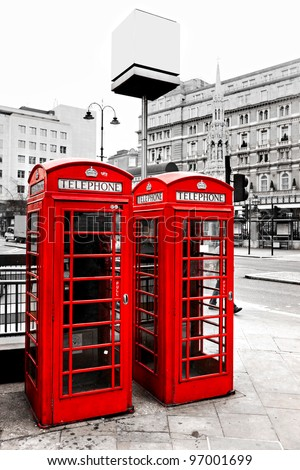 Red telephone boxes with black and white background, London, UK.