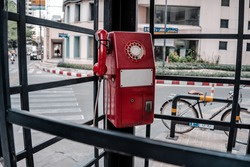 Red, telephone public payphone  in Bangkok, Thailand.