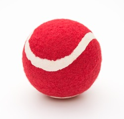 red tennis ball for pet on a white background
