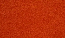 red terry towel textured background closeup enlarged