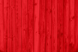 Red texture of pine wood grain with knots. Abstract red background.