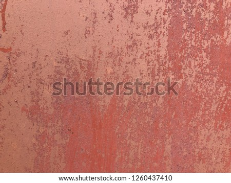 red texture of shabby paint and plaster cracks wall for background.