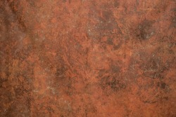 Red texture painted on canvas. Artist red primed cotton mottled grunge background.