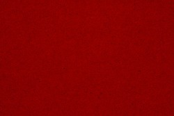 Red textured cardstock paper closeup background with copy space for message or use as a texture