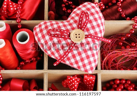 Red thread and material for handicrafts in box close-up