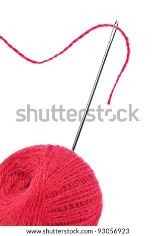 Red thread ball and needle with pink thread isolated on white