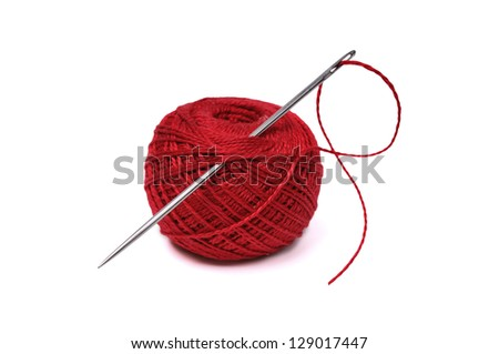 Red thread ball and needle with red thread isolated on white - stock photo
