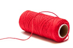 Red thread on white background. Roll red rope.
