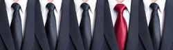Red tie between black neckties as stand out of the pattern or crowd concept