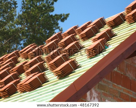 red tile roof in stacks before laying