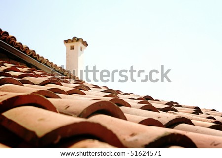 Red tile roof with chimney.