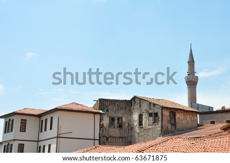 Red tile roofs and minaret in Ankara, Turkey
