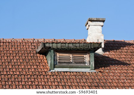 Red tiled roof with chimney and dormer window