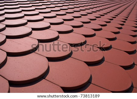 Red tiles of a newly built house