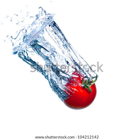 Red Tomato Falls under Water with a Splash, isolated
