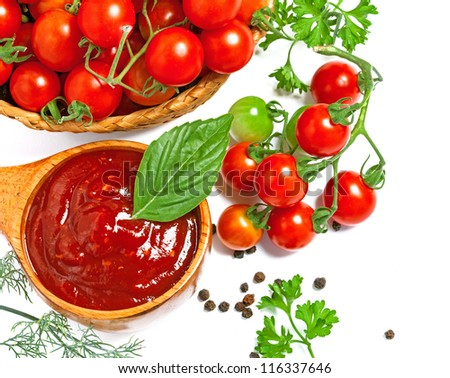 Red tomato sauce in a wooden spoon and ingredients, isolated in white