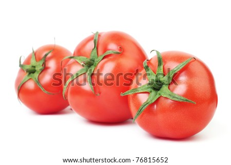 Red tomato. Three ripe tomatoes isolated on white background.