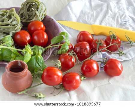 Red tomatoes and basil, ingredients for a simple pasta sauce #1018895677