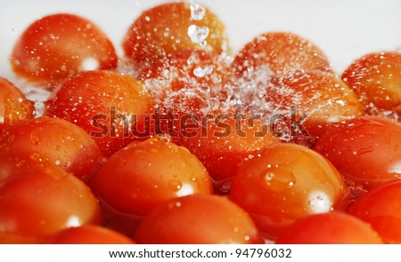 Red tomatoes and water splash.