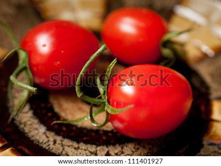 Red tomatoes on a ceramic plate