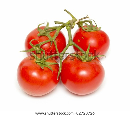 Red tomatoes on the green branch