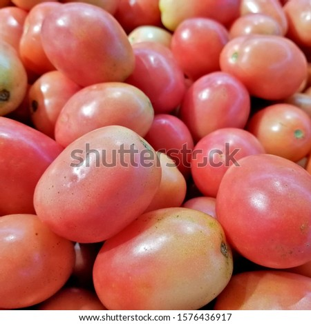 Red tomatoes or cherry tomatoes background. Group of tomatoes or group cherry tomatoes. #1576436917