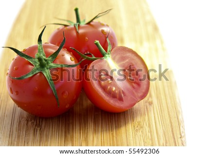 Red Tomatoes with one Sliced in Half