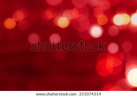 Red tone blur bokeh light. Defocused background with space.