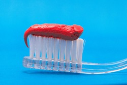 Red toothpaste on blue