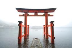 Red torii on the Hakone lake, Japan