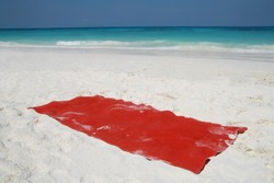 red towel for sunbath on beautiful beach surface background ,travel landscape clean white sand and blue sea water wave ripple similan island group, Phang nga, Thailand