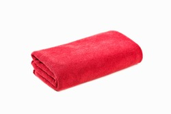 Red towel isolated on white background.