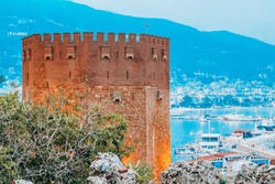Red tower Kizil Kule in summer 2019. Alanya, Turkey